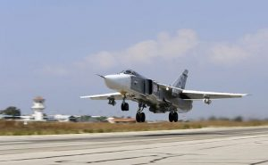 In this photo taken on Saturday, Oct.  3, 2015, Russian  SU-24M jet fighter armed with laser guided bombs takes off from a runaway at Hmeimim airbase in Syria.  Russia has insisted that the airstrikes that began Wednesday are targeting the Islamic State group and al-Qaida's Syrian affiliates, but at least some of the strikes appear to have hit Western-backed rebel factions. (AP Photo/Alexander Kots, Komsomolskaya Pravda, Photo via AP)